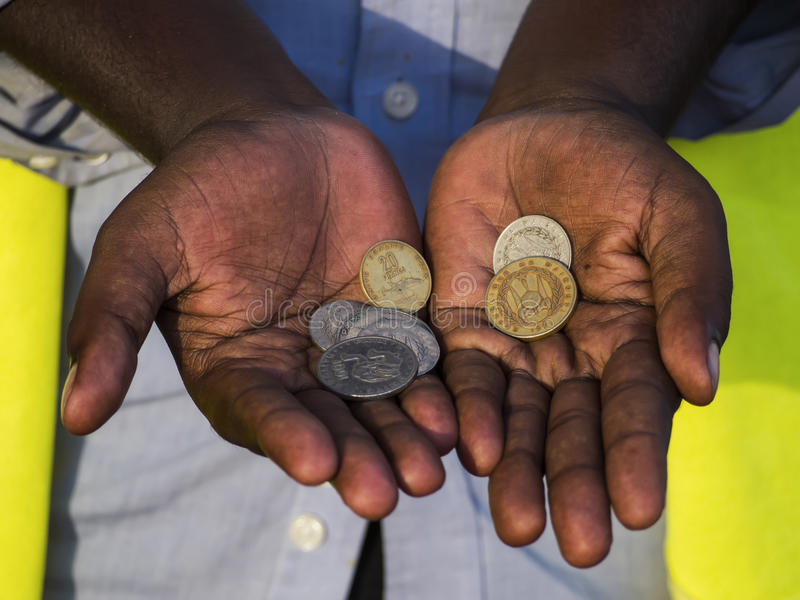Coins in the hands stock photography