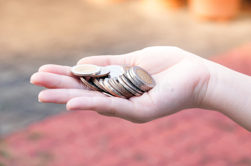 Coins in hands saving,Donation Investment Fund Financial Support Charity Dividend Market House. Stock Trust Wealthy Giving Planned Accounting Collection Debt royalty free stock photo