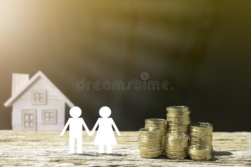 Coins house and family. stock photography