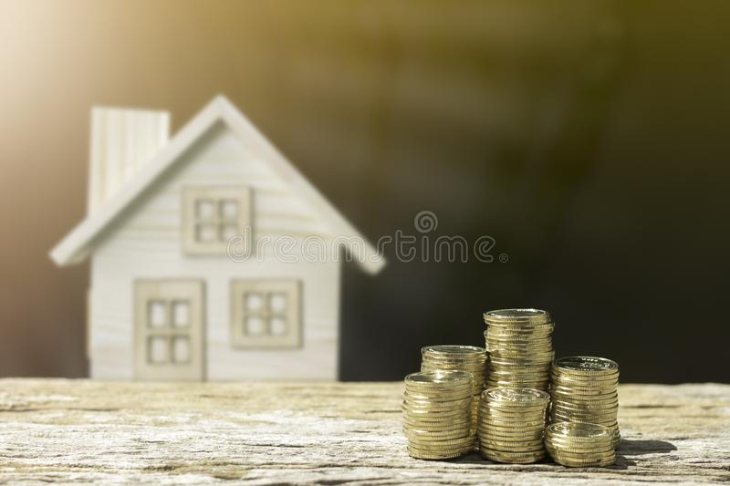 Coins and house to savings money. stock image