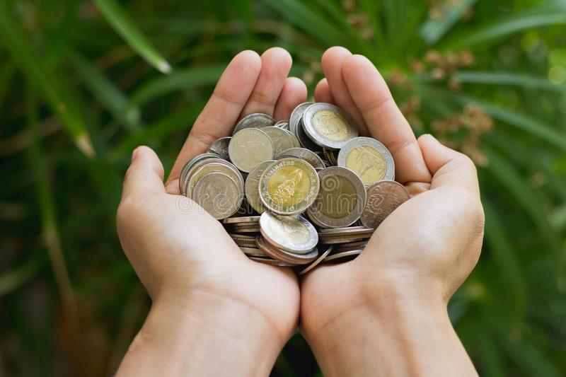 Coins in human hands, Save money for the future business, investment and finance concept stock images