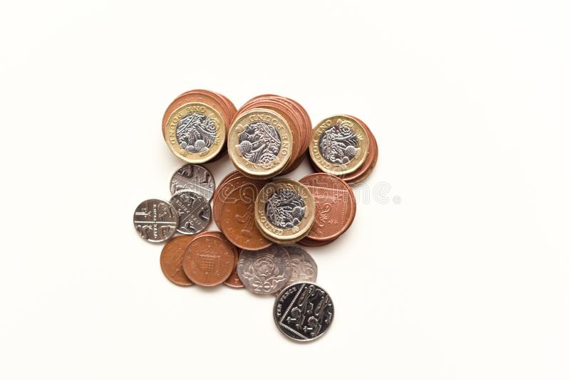 Coins isolated on white British currency representing uk economy and markets. In uk royalty free stock photography