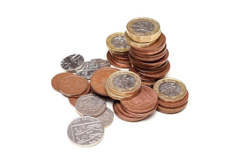 Coins isolated on white British currency representing uk economy and markets. In uk stock photo