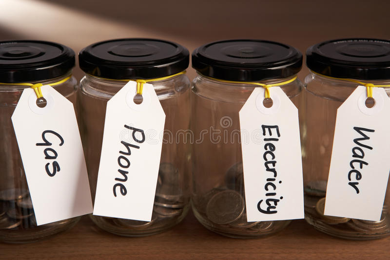 Coins in a jam jar royalty free stock photo