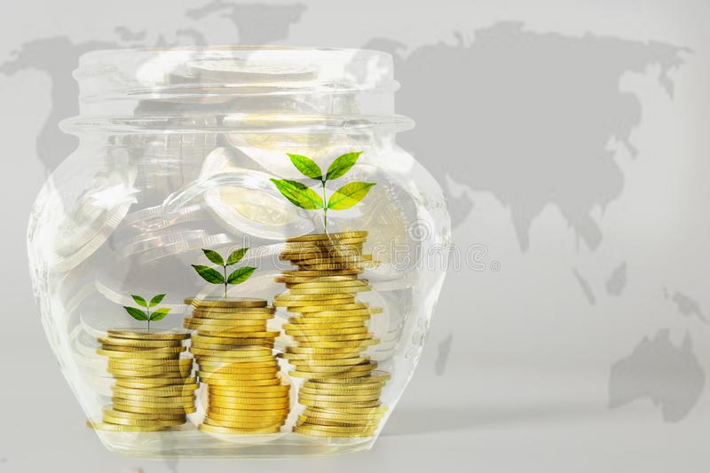 Coins in jar with money stack, Concept finance, accounting, business and saving investment. stock photo