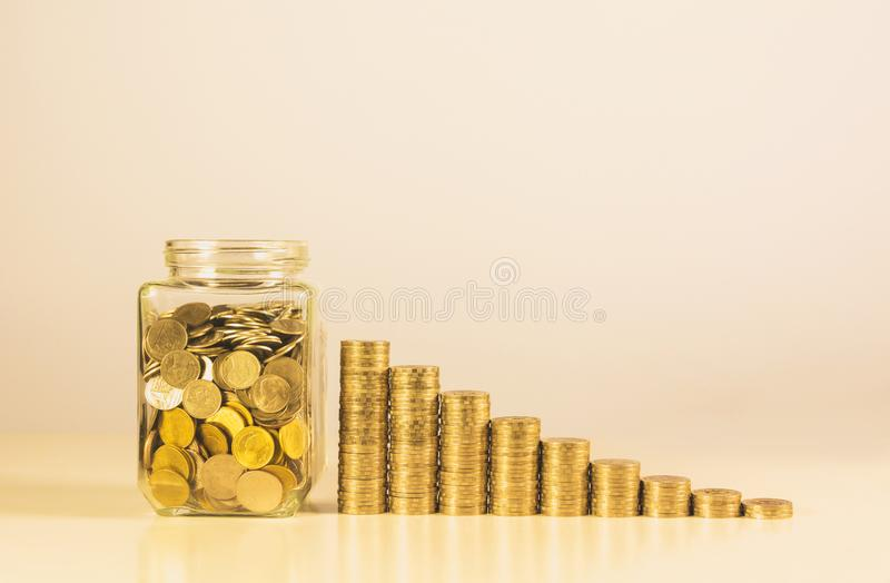 Coins in jar with money stack step growing money stock photography