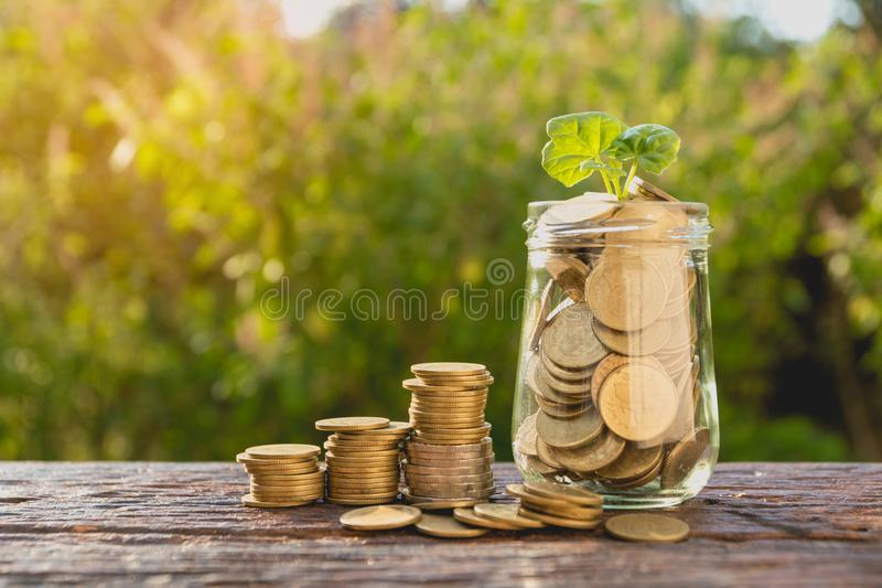 Coins in jar with money stack step growing money, Concept finance business and saving investment. stock photography