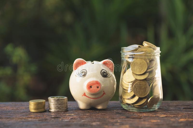 Coins in jar with money stack step growing money and piggy bank, Concept finance business and saving investment. stock images