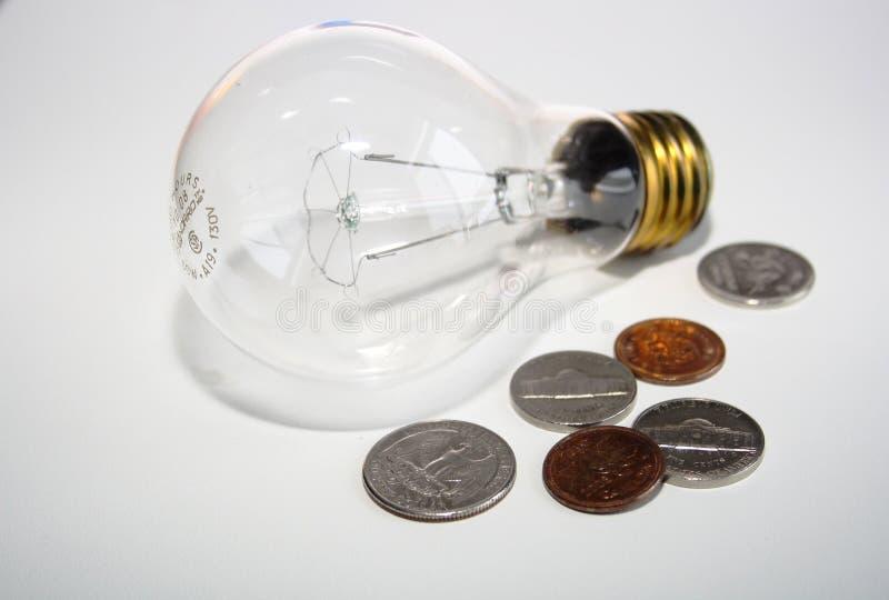 coins lightbulben royaltyfri fotografi