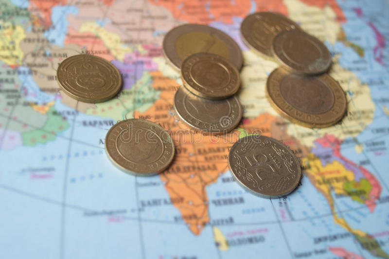 Coins on the map royalty free stock images