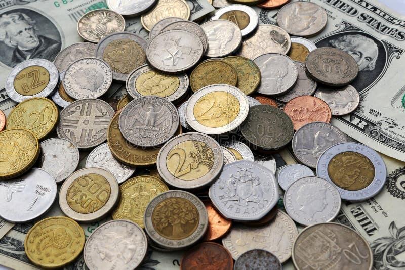 Coins. Money euro dollar pesos royalty free stock photography