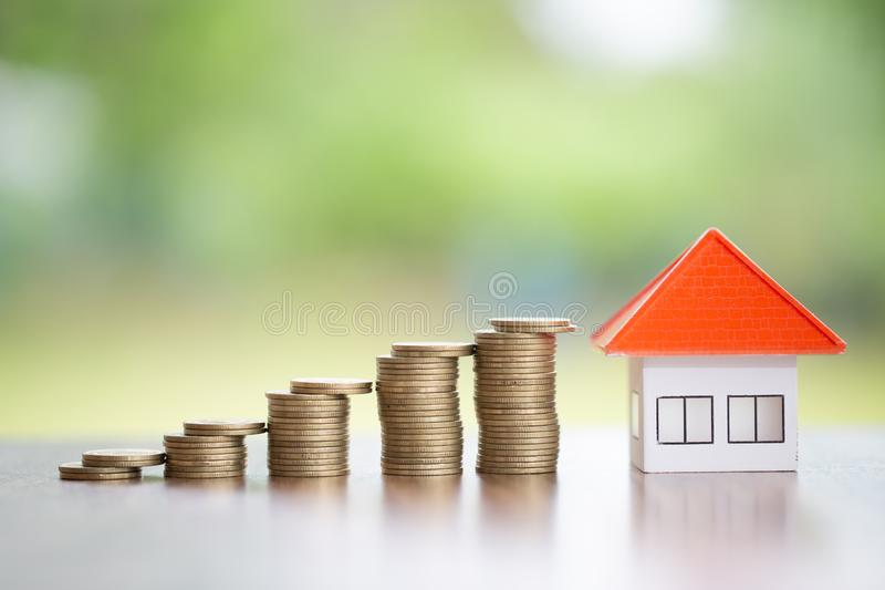 Coins money setting growth up increase to house model for concept investment mortgage finance and home loan business, business, royalty free stock photos
