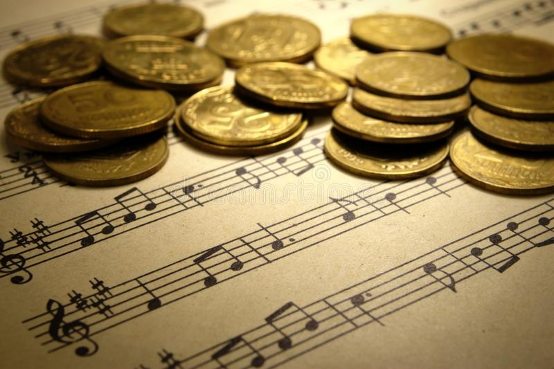 Download Coins On A Musical Notebook Stock Photo - Image of classical, note: 22736986