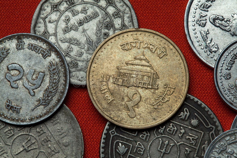 Coins of Nepal. Bageshwori Temple in Nepalgunj. Nepal depicted in the Nepalese one rupee coin royalty free stock photo