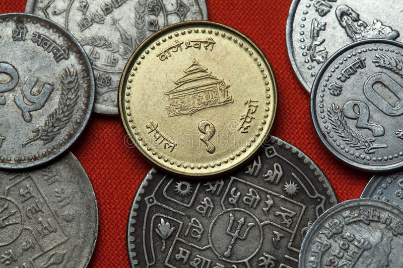 Coins of Nepal. Bageshwori Temple in Nepalgunj. Nepal depicted in the Nepalese one rupee coin stock photos