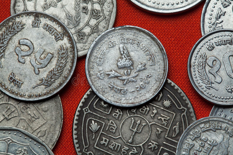 Coins of Nepal. Nepalese royal crown. Depicted in the Nepalese five paisa coin stock images