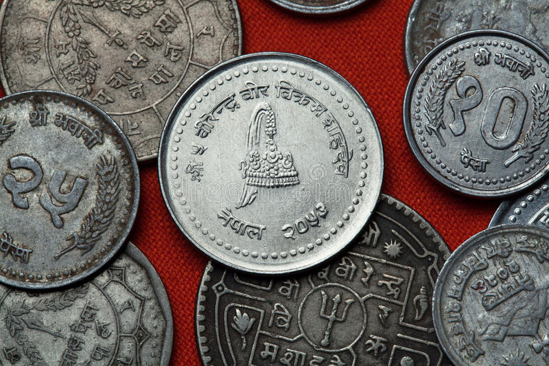 Coins of Nepal. Nepalese royal crown. Depicted in the Nepalese 50 paisa coin stock photo