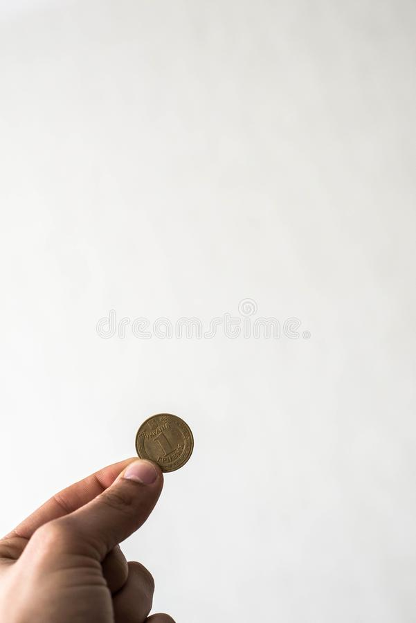 Coin in hand royalty free stock image