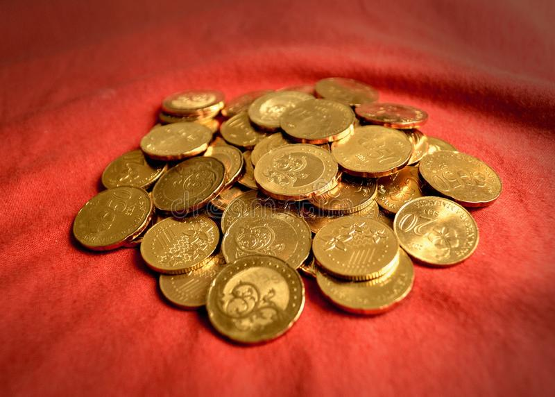 Coins over red. Image of coins over red background stock photo