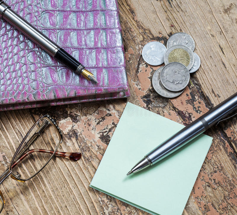 Coins and pen royalty free stock images