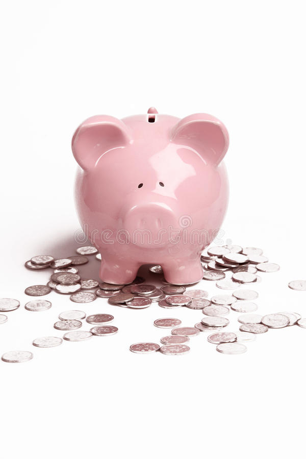 Coins and a piggy bank royalty free stock images