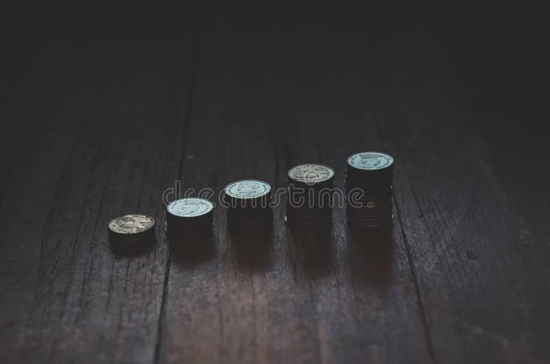 Coins placed in rows stock image