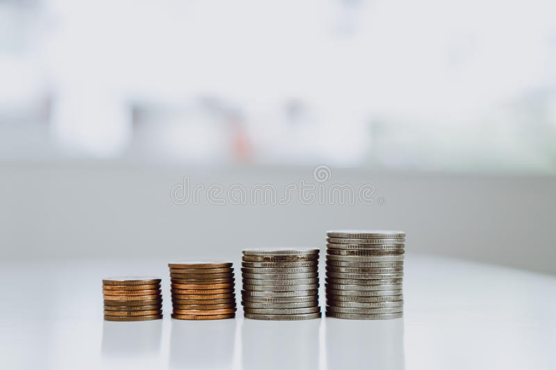 The coins placed on the table are the rows representing the economic growth rate of the business. The financial concept royalty free stock photo