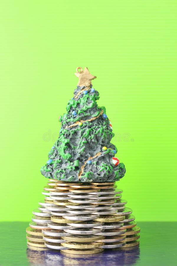 Coins, pyramid, Christmas tree. The new year holiday. Business growth concept Finance. Green background and dark . royalty free stock images