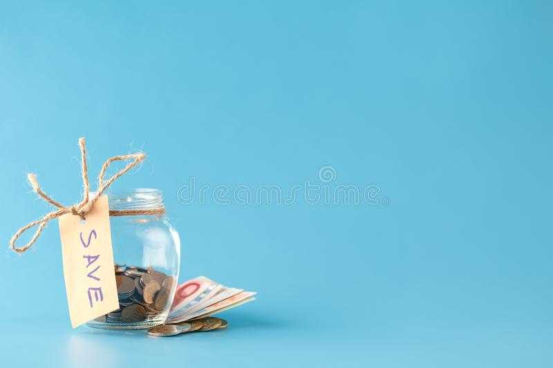 Coins in savings jar full of money royalty free stock photo