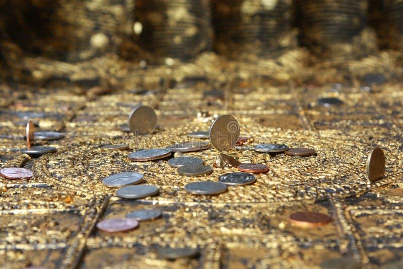 Coins set on buddha footprint stock photo