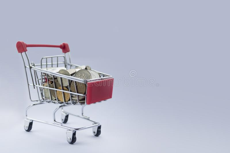 Coins in shopping cart. Banking and marketing. Cart filled with coins of Russian rubles. budget for the new year holiday. Money saving. Tips accumulate money stock photography