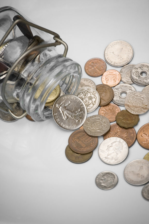 Coins spill out from a bottle royalty free stock images
