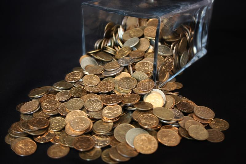 Coins spill. Out of the jar stock photo