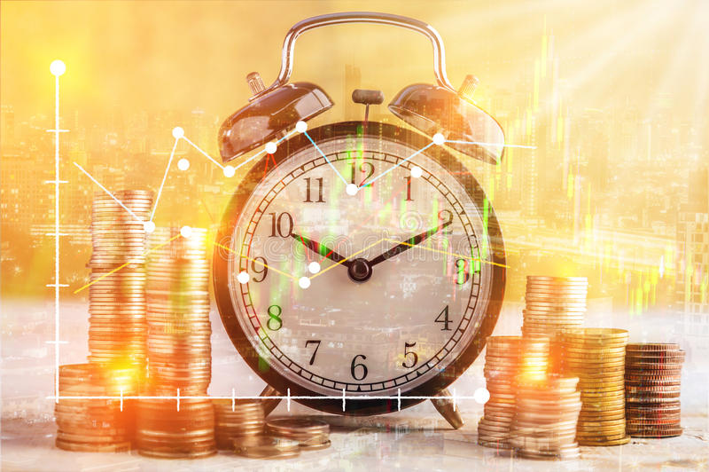 coins stack and alarm clock on golden background business concept overlay with financial graph stock with night street view stock photography