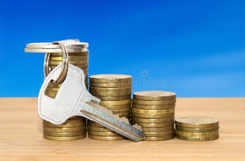 Coins stack with keys royalty free stock photos