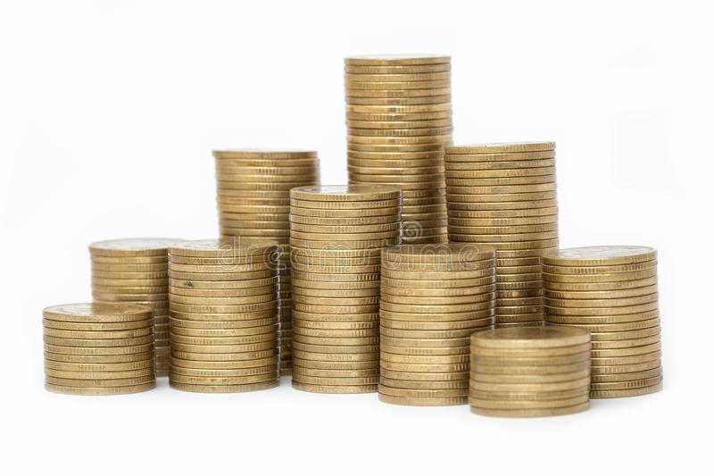 Coins stacked on each other in different positions, Money saving, financial risk management, business investment, White background stock images