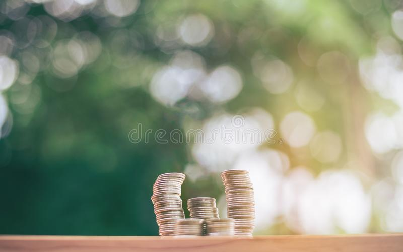 Coins are stacked on the table. planning savings money of coins to buy a home concept concept for property ladder. Mortgage and real estate investment. for royalty free stock image
