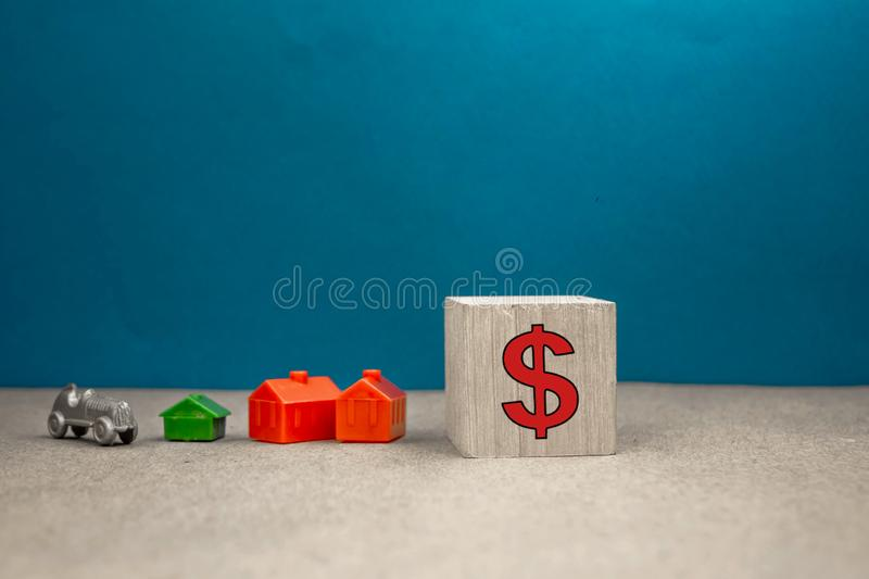 Coins stacks and car and house on white background,business saving and investment concept. Hand, heart, money, paper, cash, dollar, estate, home, loan royalty free stock photos