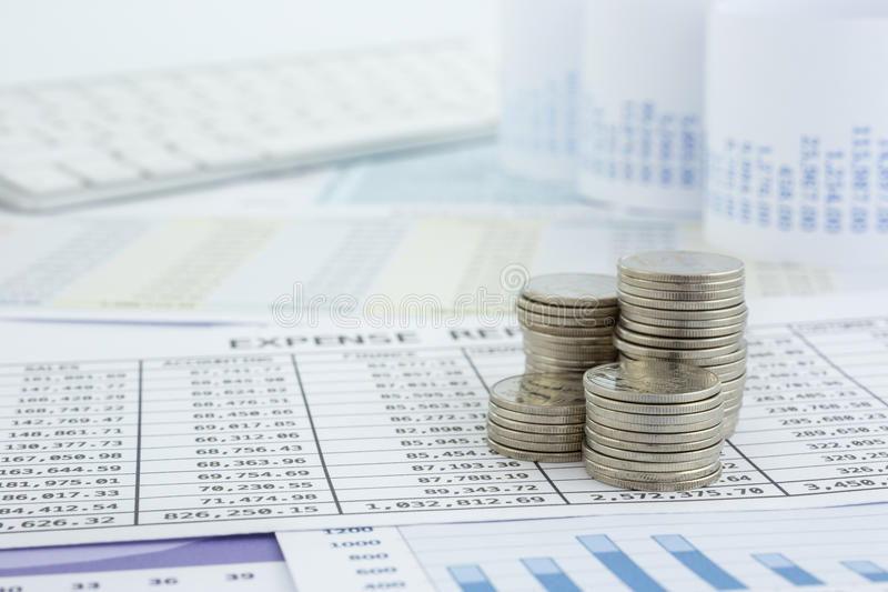 Coins stacks money and reports stock images