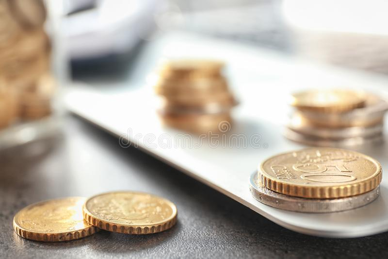 Coins on table, closeup. Concept of savings royalty free stock image