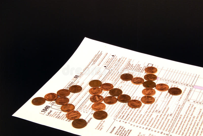 Coins on Tax Return form stock photography