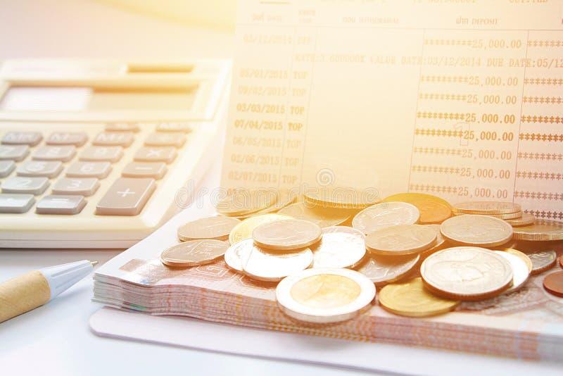 Coins, Thai Money, Pen, Calculator And Savings Account Passbook On