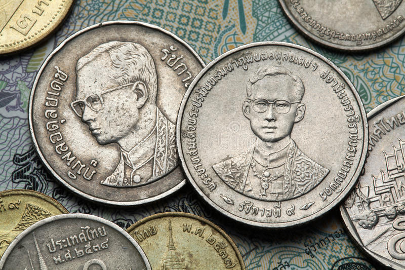 Coins of Thailand. King Bhumibol Adulyadej of Thailand depicted in the Thai baht coins royalty free stock images