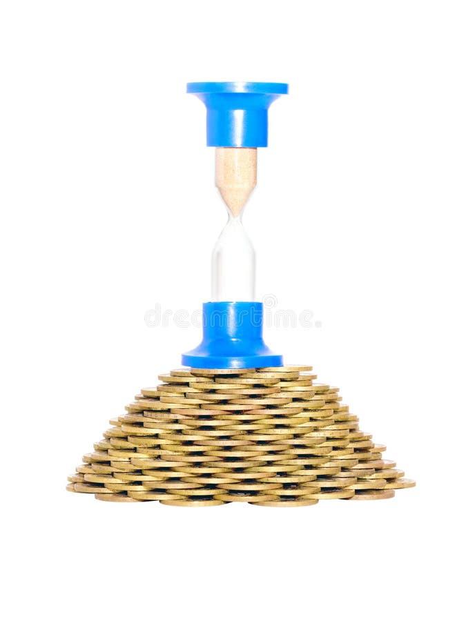 coins timglaspyramiden royaltyfri fotografi