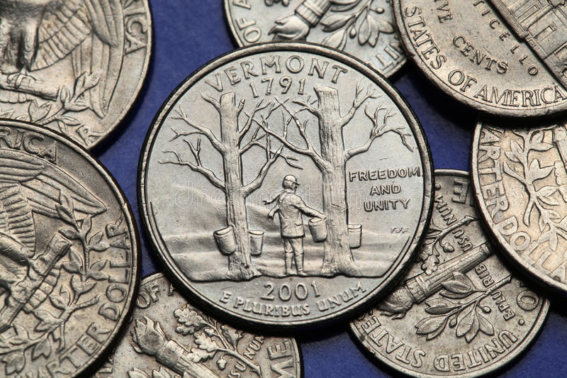 Coins of USA. US 50 state quarter. Coins of USA. Maple trees with sap buckets and Camels Hump Mountain depicted on the US Vermont quarter (2001 royalty free stock image