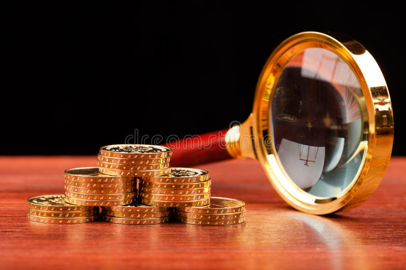 Money concept. Coins on wooden table and black background stock photo
