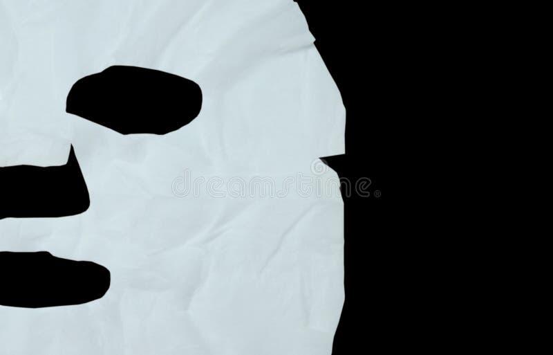 cojín blanco de la mascarilla en fondo negro foto de archivo libre de regalías