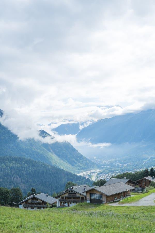 Col de Voza chalets. COL DE VOZA, FRANCE - AUGUST 24: Chalets with Les Houches village in the background. Les Houches is one of the Tour du Mont Blanc villages stock images