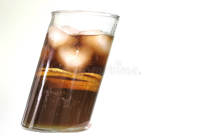 Cola. In a diagonal glass, macro, shallow DOF stock images