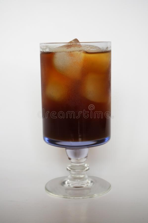 Closeup of Cola, black coffee, on champagne glass royalty free stock image
